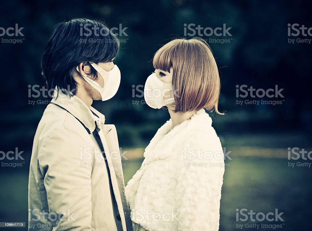 japanese couple with surgical mask royalty-free stock photo