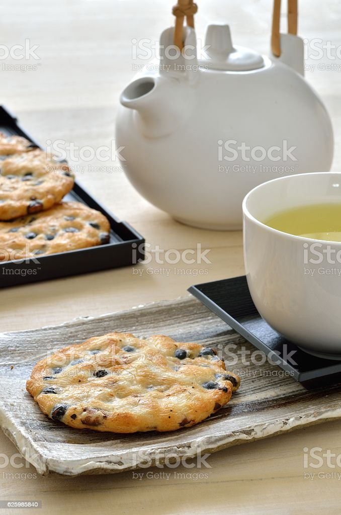 Japanese crackers with green tea stock photo