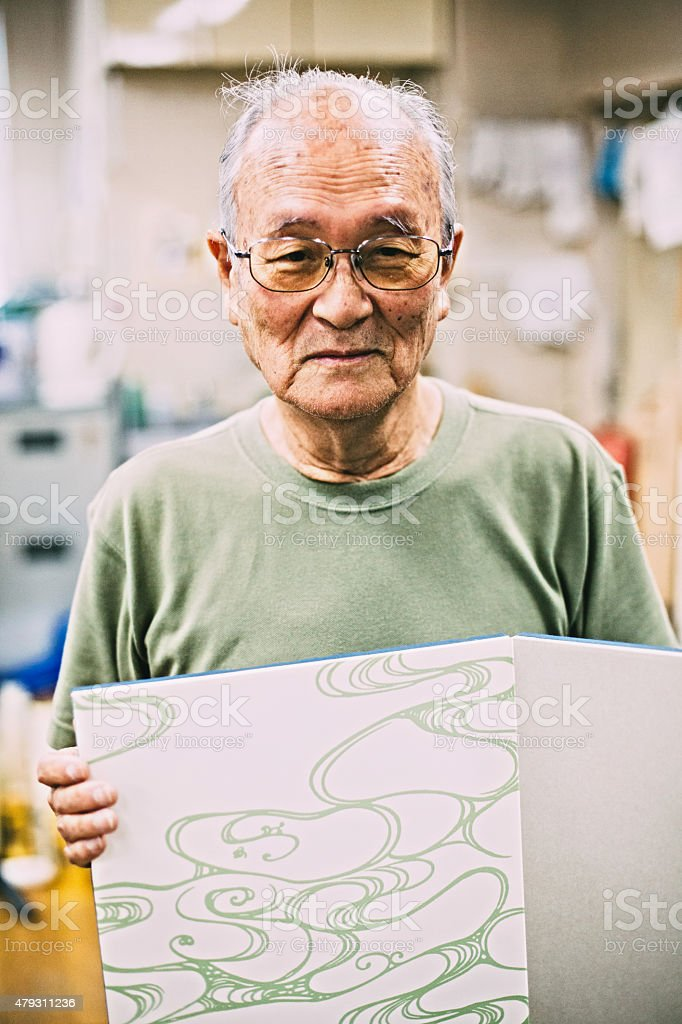 Japanese craftsman is showing his craft work stock photo