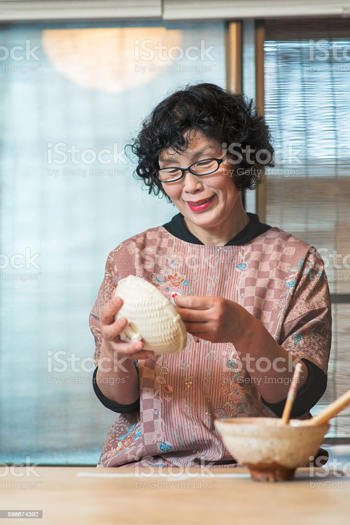 Japanese Craftsperson making a paper bowl stock photo