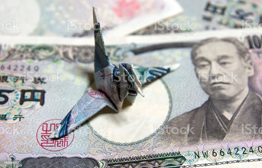 Mandschurenkranich und Währung Lizenzfreies stock-foto