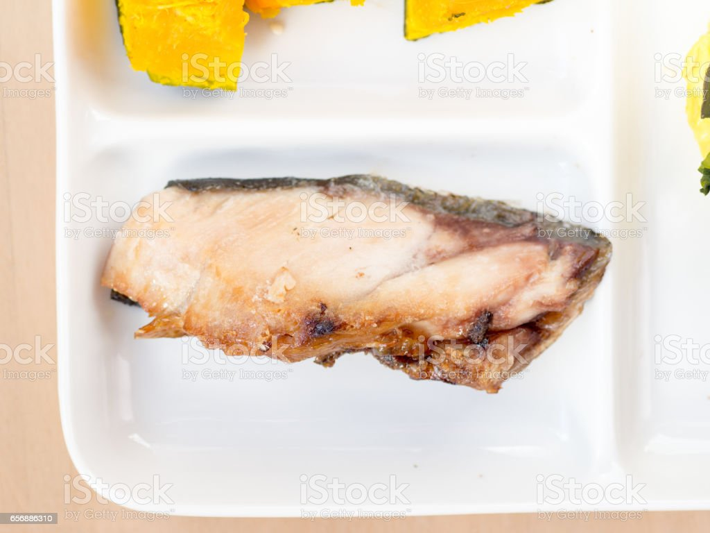 Japanese cuisine, a piece of sliced and grilled yellowtail stock photo