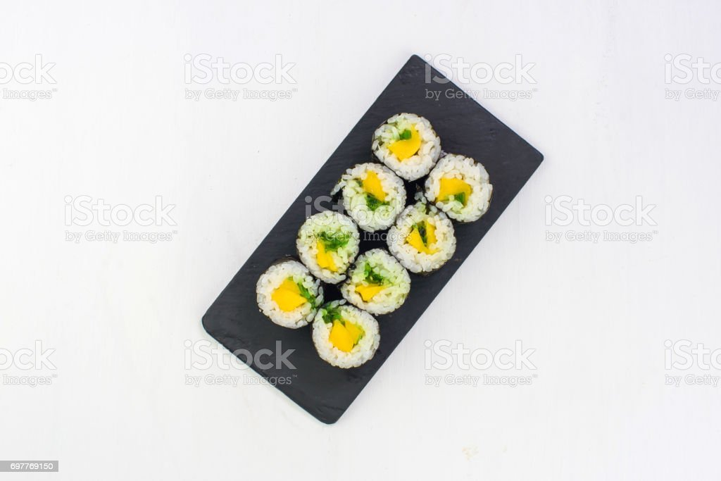 Japanese cuisine. Sushi roll with avocado on white background stock photo