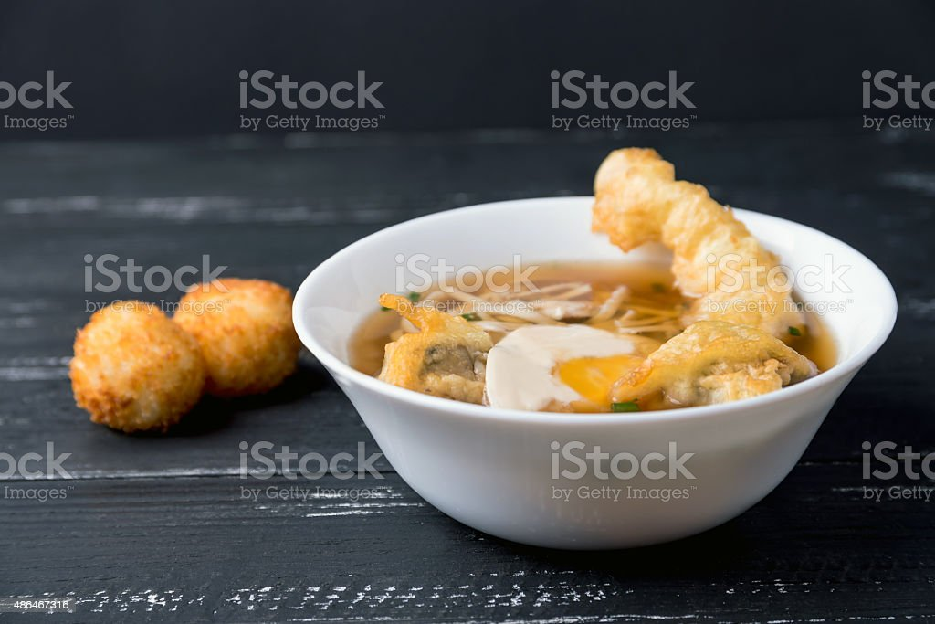 Japanese cuisine, Udon noodles with shrimp tempura stock photo