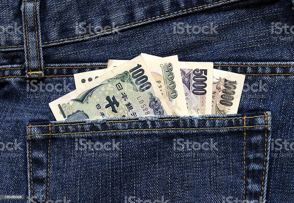 Japanische Währung in Hüfte pocket-jeans Lizenzfreies stock-foto