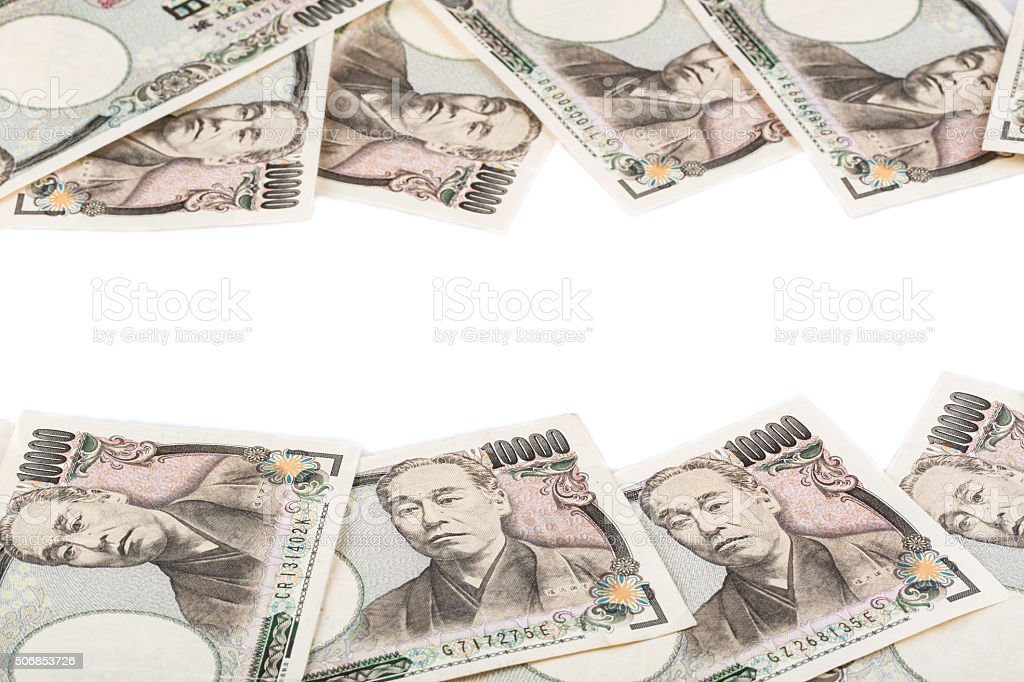 Japanese currency yen or Japanese banknotes over white background stock photo
