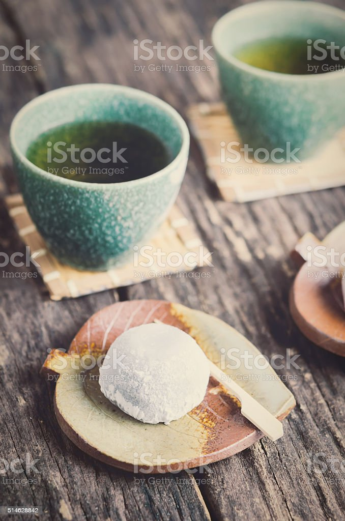 Japanese dessert with cup of green tea stock photo