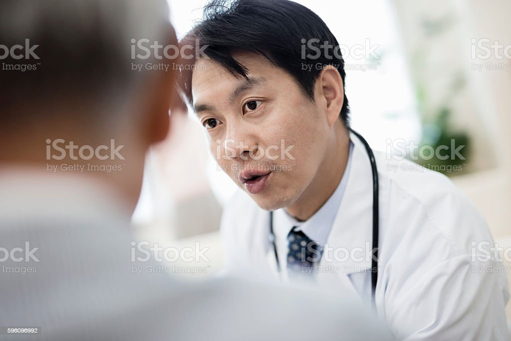 japanese doctor explaining senior patient stock photo