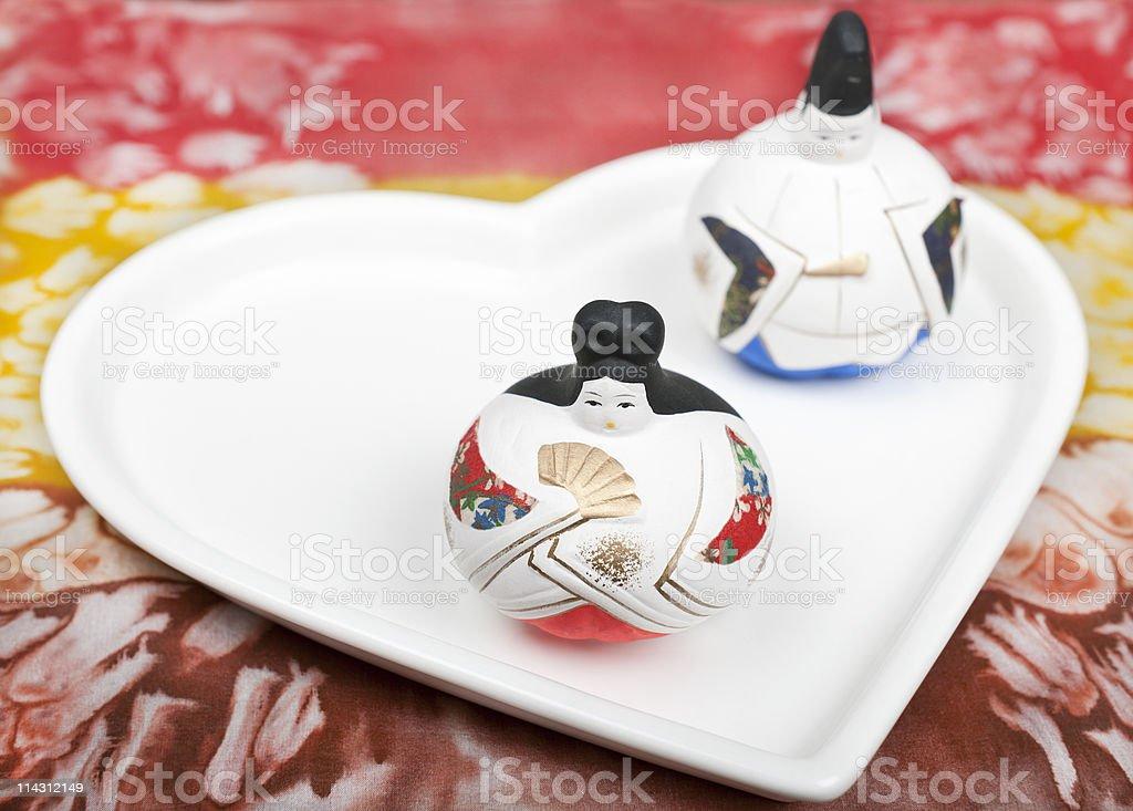 Japanese Dolls on White Heart royalty-free stock photo