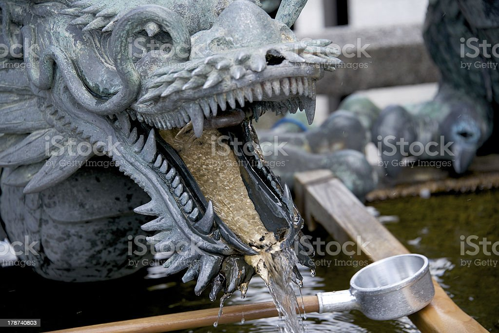 Japanese dragon - purification trough in temple royalty-free stock photo