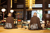 Japanese during their morning ceremony inside a Buddhist Temple