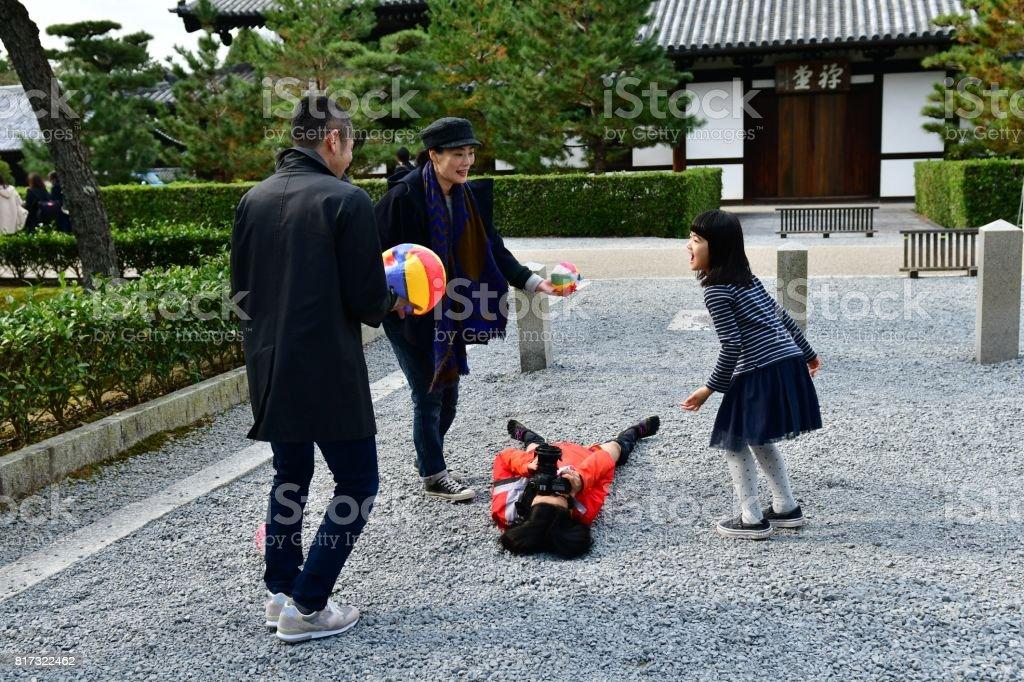 Japanese Family and Female Photographer at Tofuku-ji, Kyoto stock photo