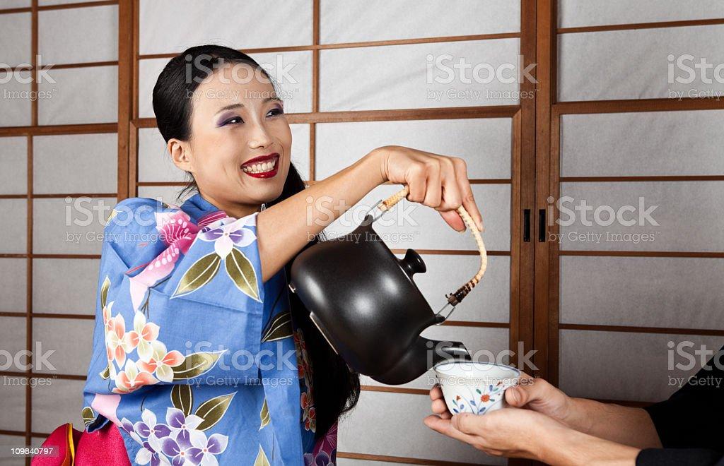 Japanese family having a tea time royalty-free stock photo