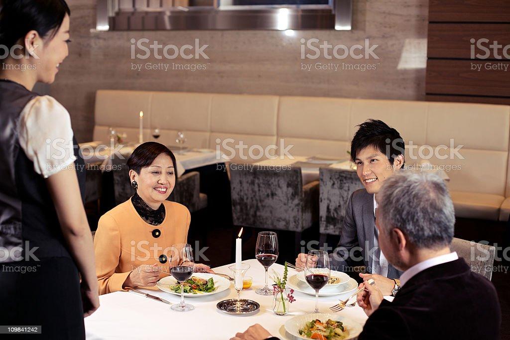 Japanese Family in Restaurant stock photo
