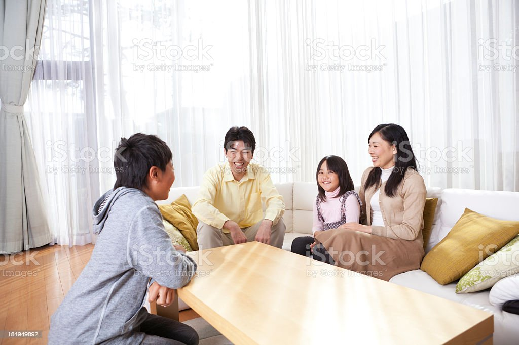 Japanese Family Relaxing in Their Home Hz royalty-free stock photo