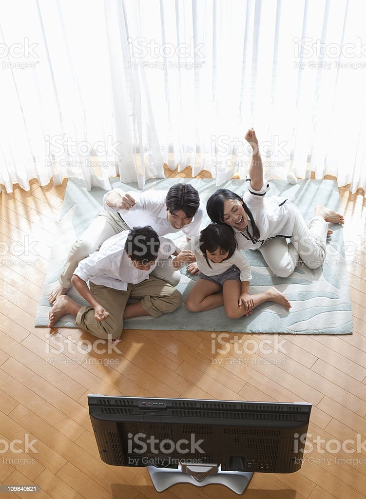 Japanese family watching television royalty-free stock photo