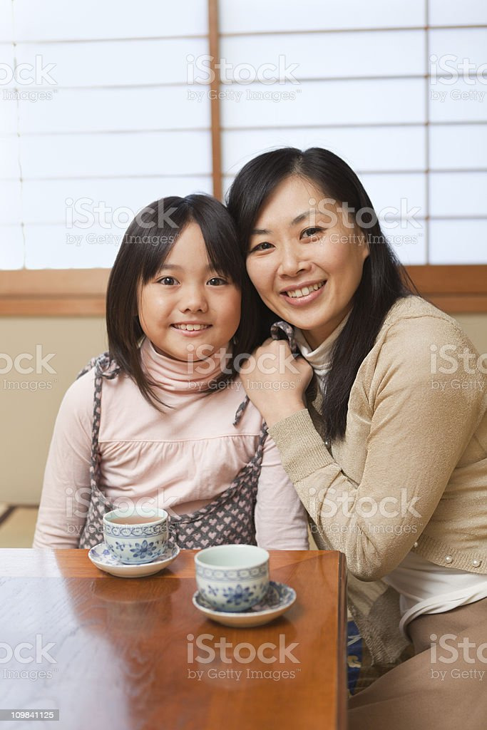 Japanese Family with Mother and Daugther in Traditional Home Vt royalty-free stock photo