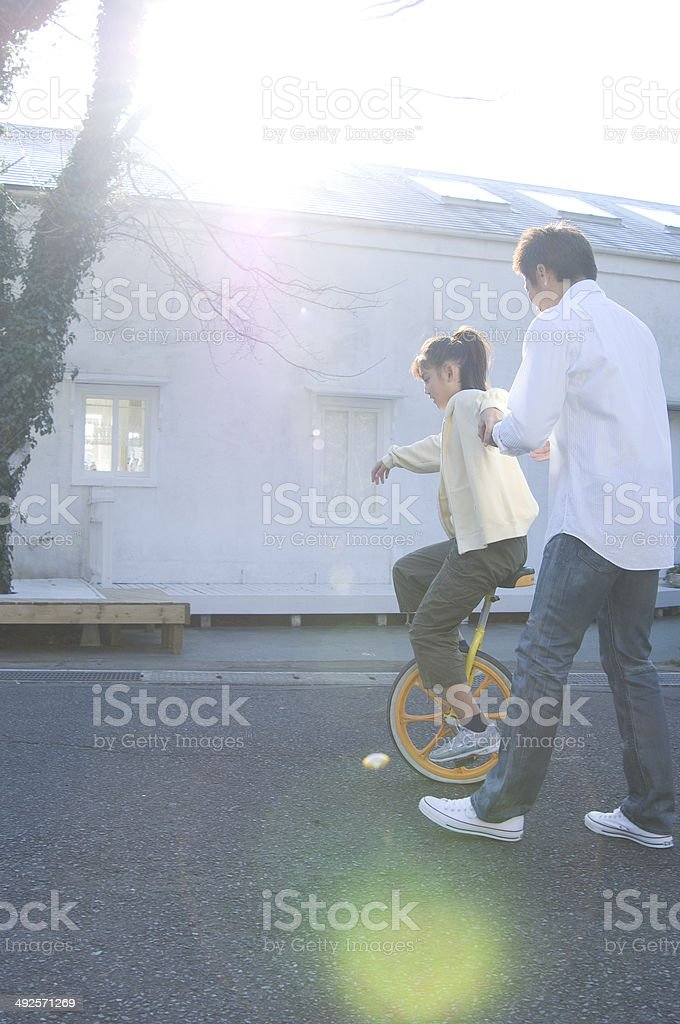 Japanese father and girl playing outdoors stock photo