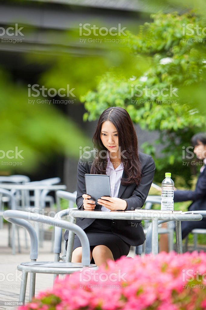 Japanese female checking her mail over lunch stock photo