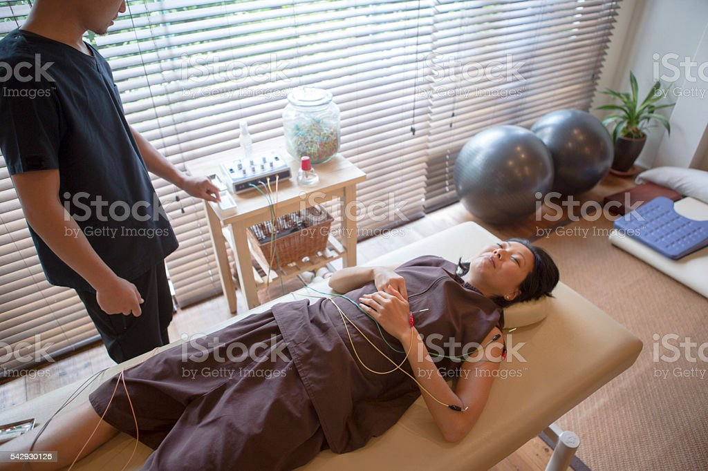 japanese female having acupuncture treatment with expert in kyoto japan stock photo