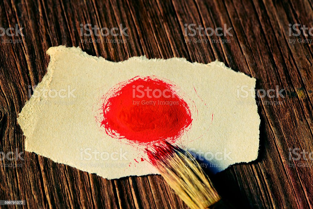 Japanese flag in a piece of paper stock photo