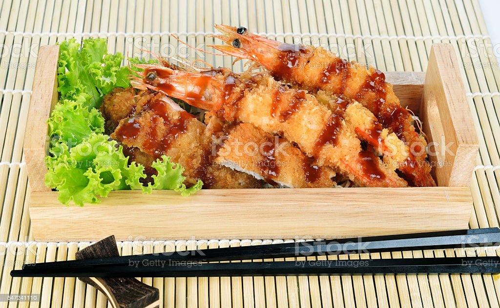 Japanese food - fried tempura shrimps and fried pork. stock photo