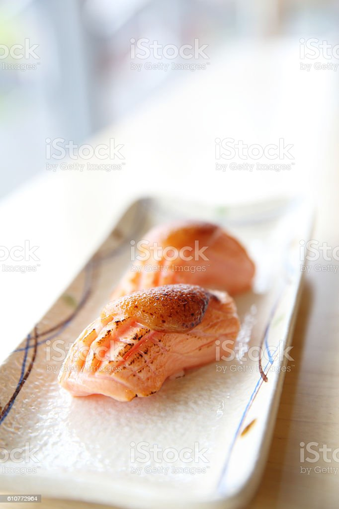 japanese food grilled salmon sushi with seafood sauce on top stock photo