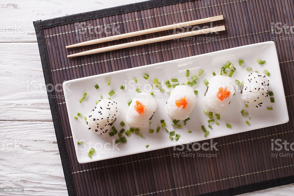 Japanese food onigiri rice balls on plate. Horizontal top view stock photo