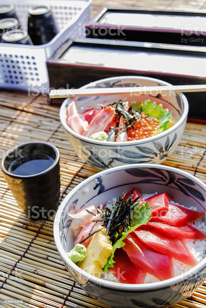 Japanese food, raw fishes, called sashimi, on the rice stock photo