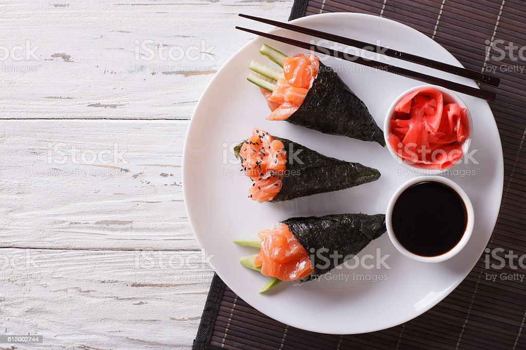 Japanese food: Salmon temaki, ginger and sauce. Horizontal top view stock photo