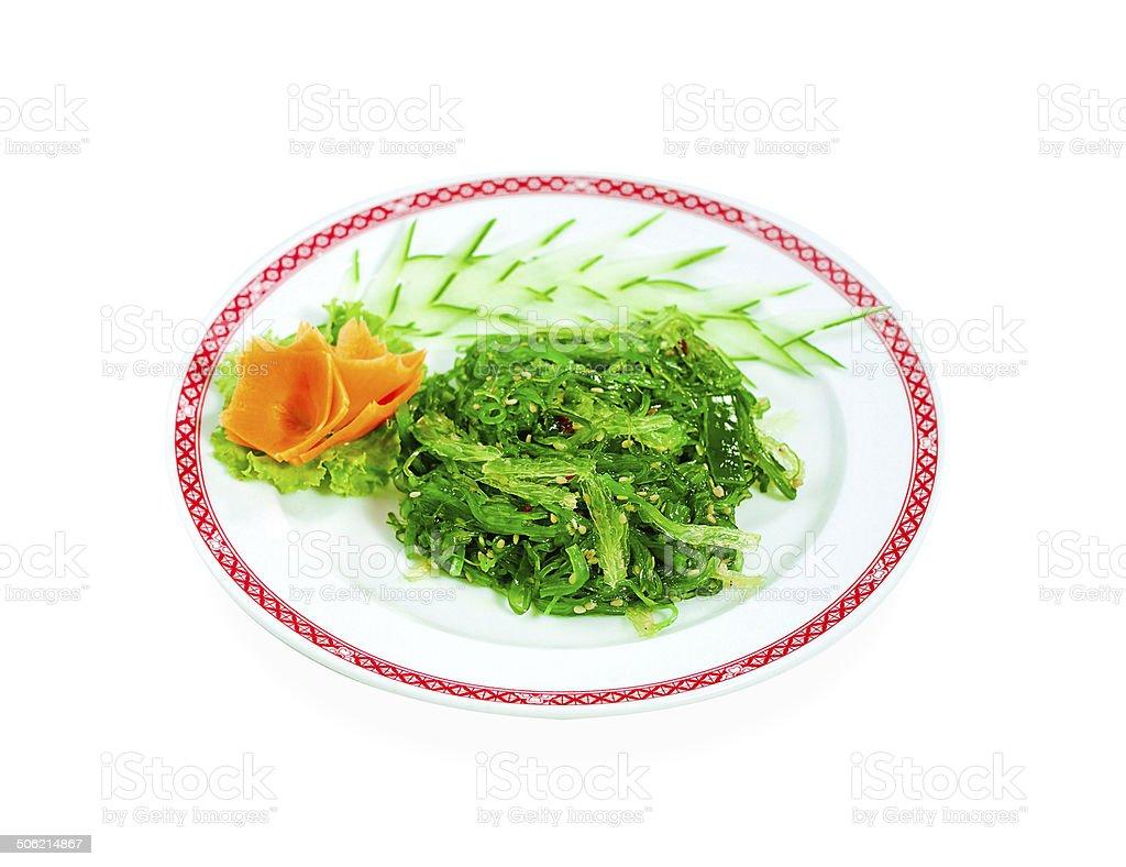 Japanese fresh seaweed salad isolated on white royalty-free stock photo