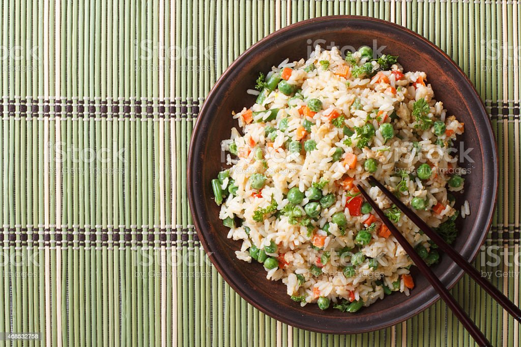 Japanese fried rice with egg and peas top view horizontal stock photo
