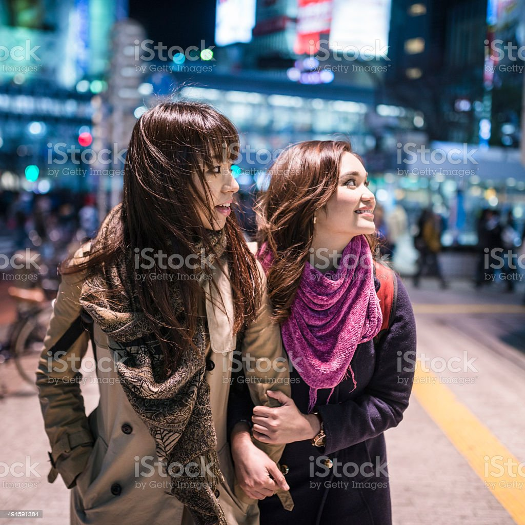 japanese friends enjoy tokyo by night stock photo