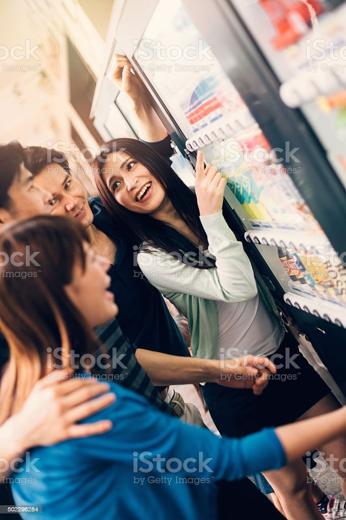 Japanese friends on a vending machine stock photo