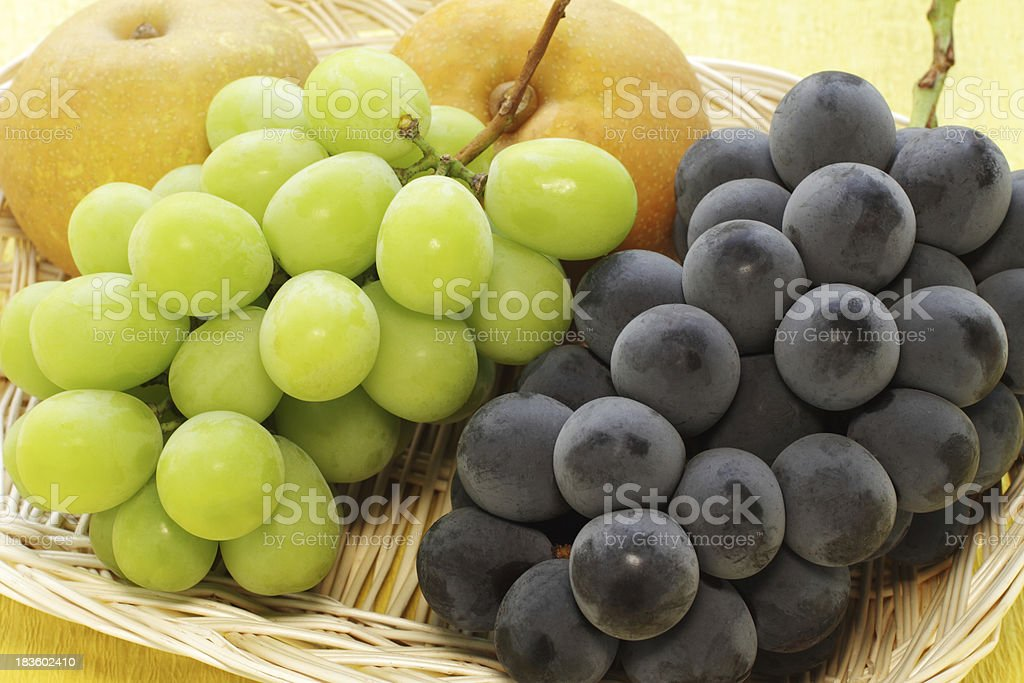 japanese fruits placed in a wicker basket royalty-free stock photo