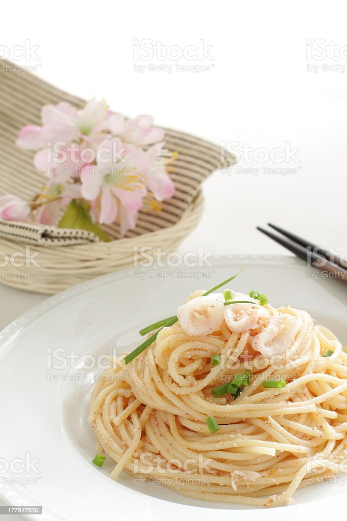 Japanese fusion food, squid and mentaiko pasta stock photo