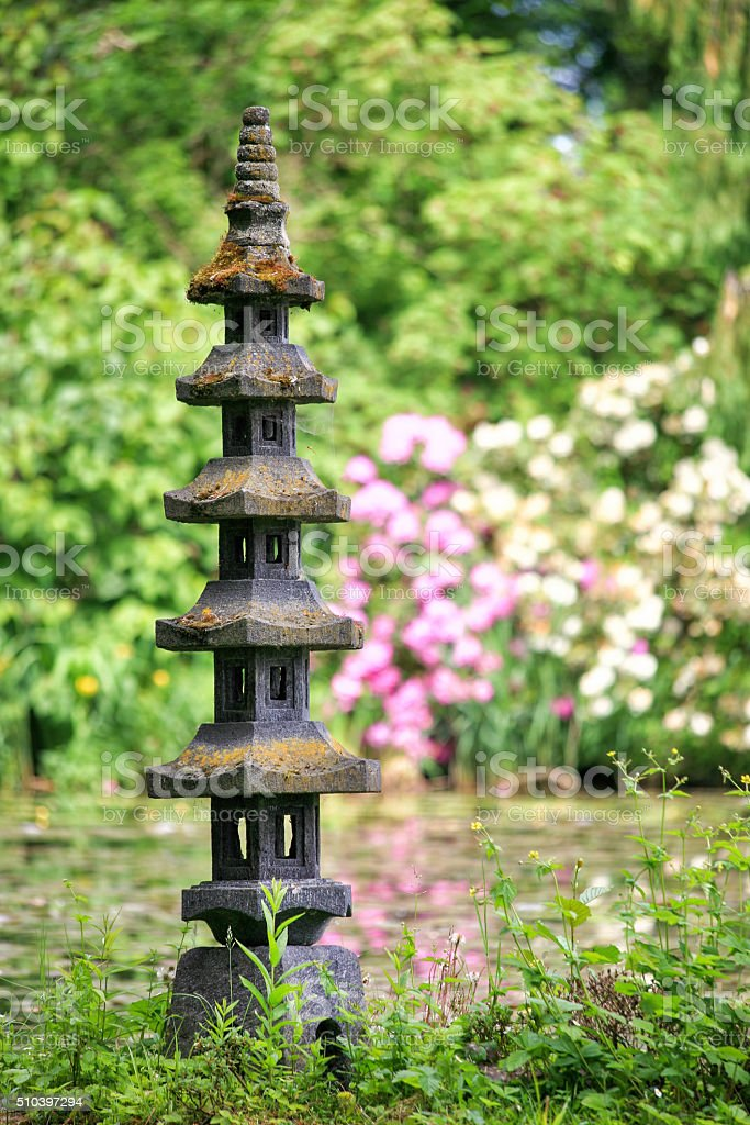 Japanese garden with small stone pagoda stock photo