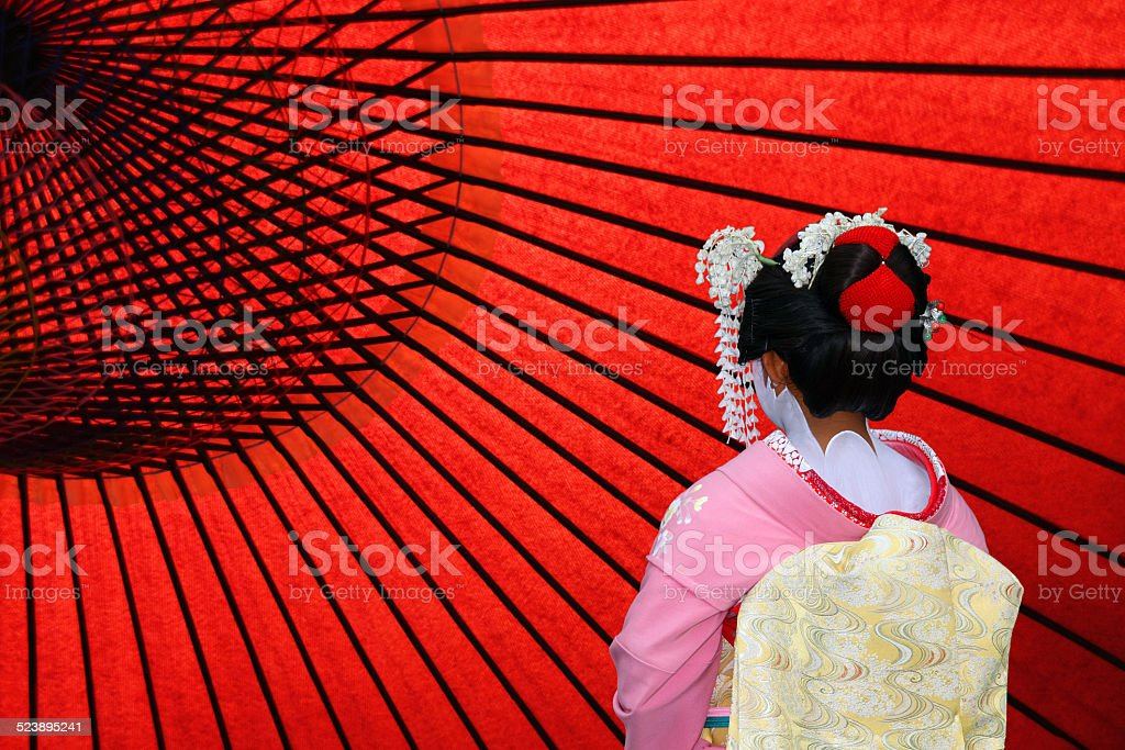 Japanese Geisha and Japanese Umbrilla stock photo