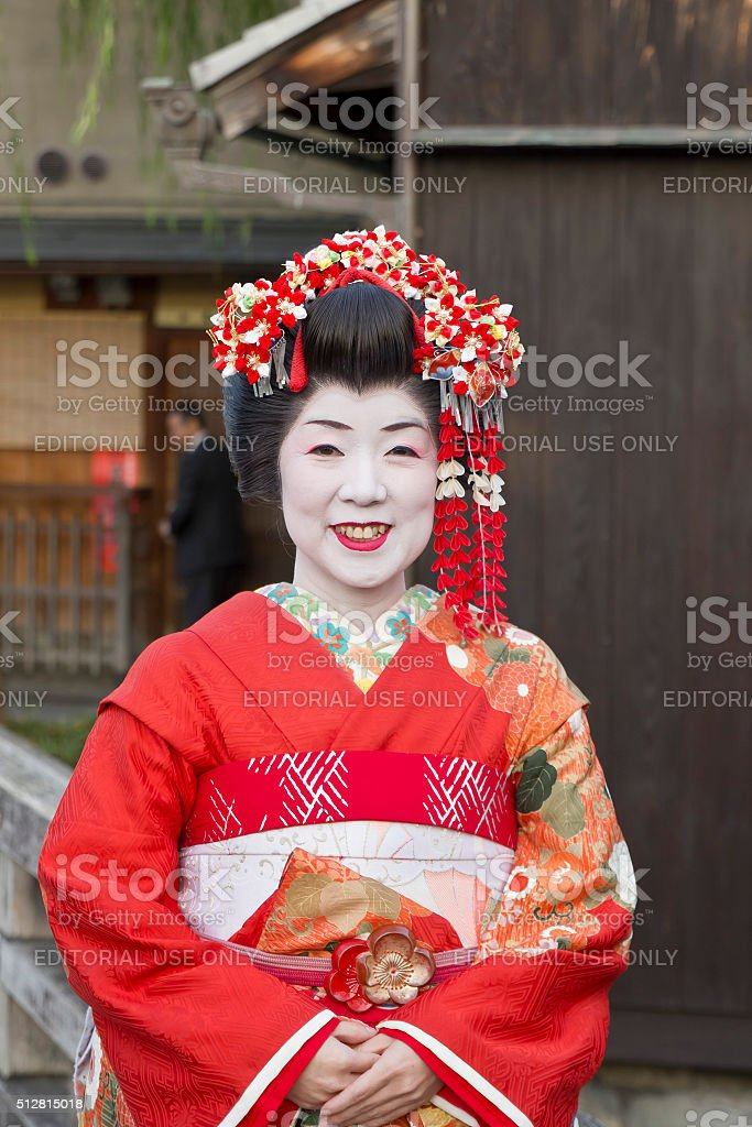 Japanese Geisha portrait on a red dress stock photo