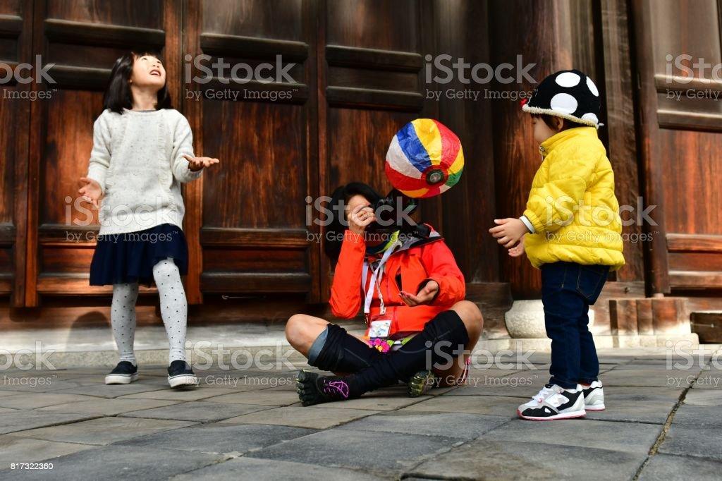 Japanese Girl, Baby Boy and Female Photographer at Tofuku-ji, Kyoto stock photo