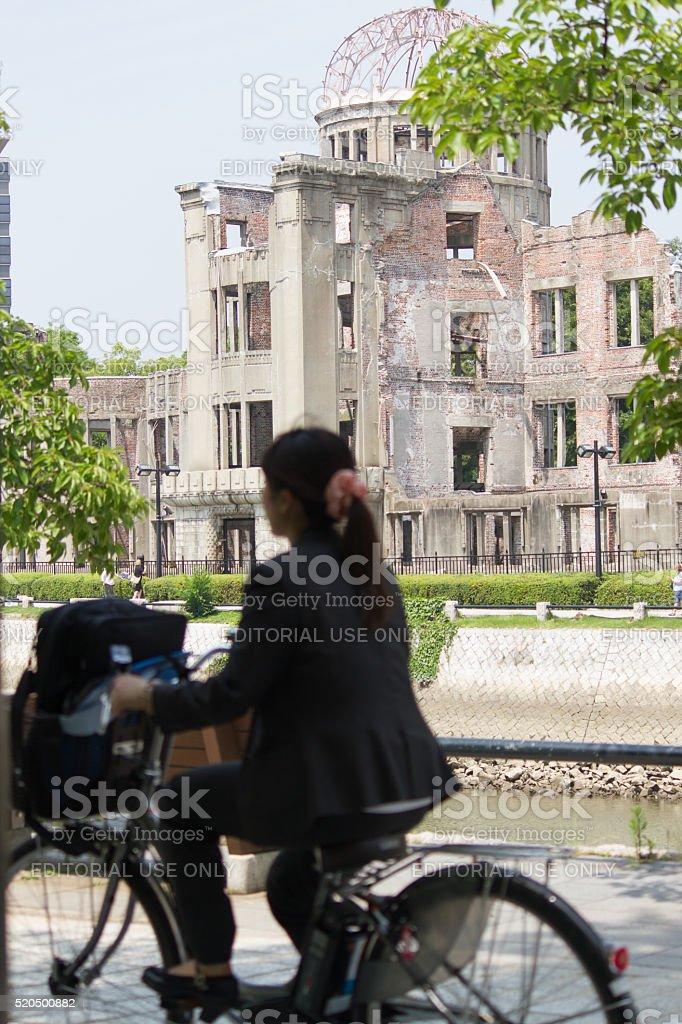 Japanese girl & Hiroshima Peace Memorial (Atomic Bomb Dome) stock photo