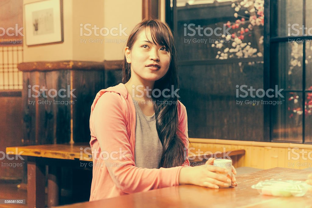 japanese girl in a Kyoto tea room stock photo