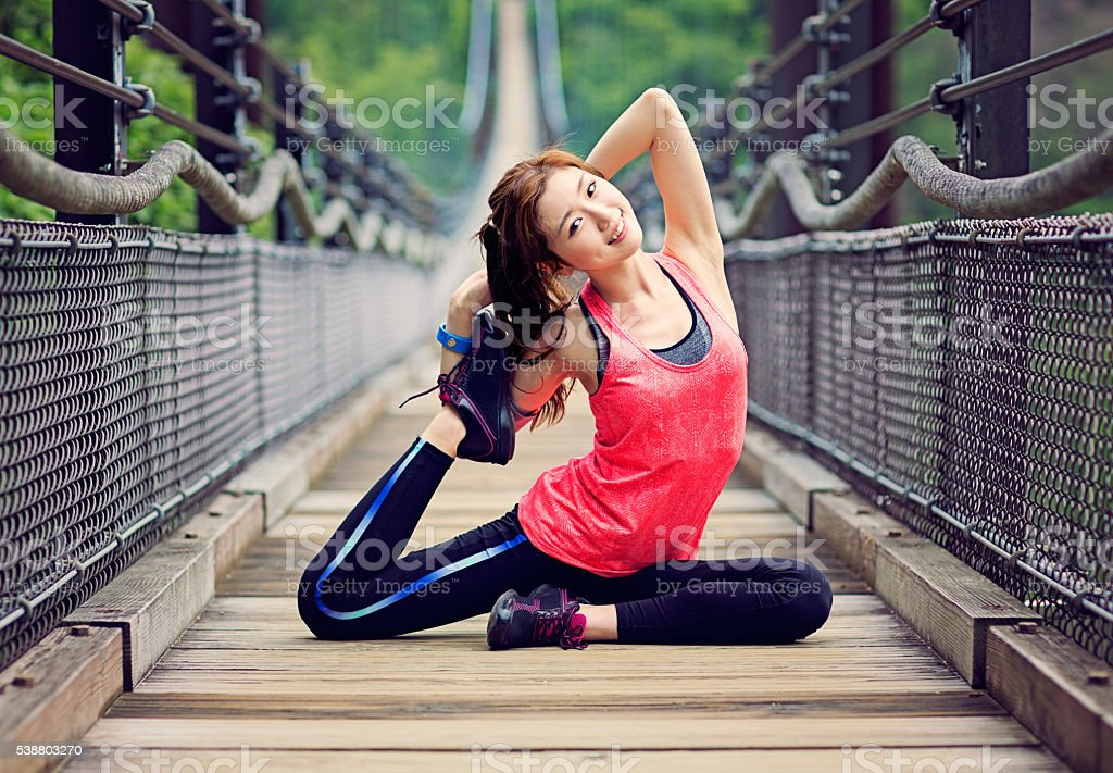 Japanese girl is stretching stock photo