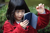 Japanese girl playing with smartphone