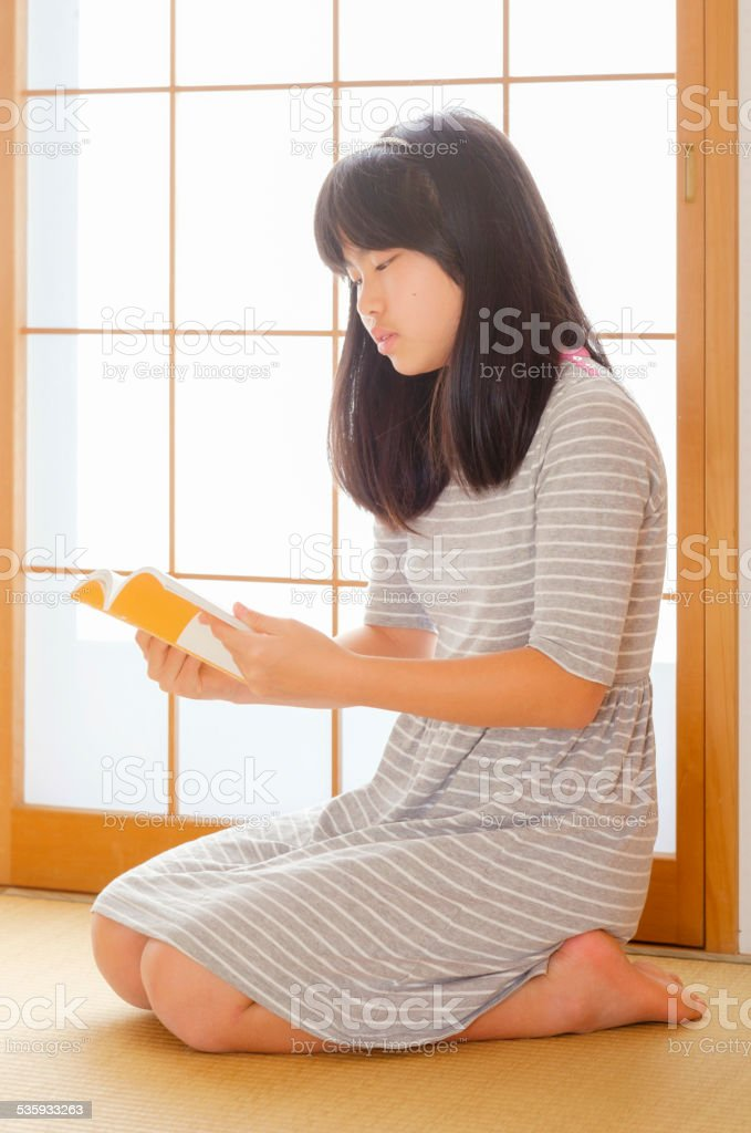 Japanese Girl Reading stock photo