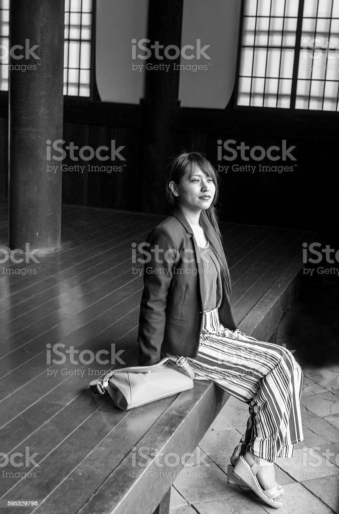 japanese girl sitting at Hyakumanben Chionji Temple in kyoto japan stock photo
