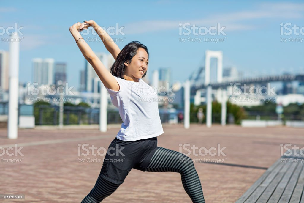 Japanese girl stretching in the morning at Tokyo stock photo