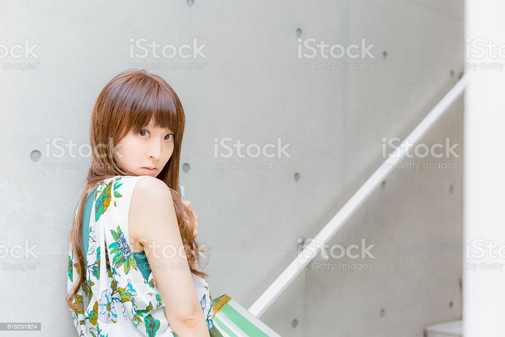 Japanese girl waiting for someone at steps stock photo