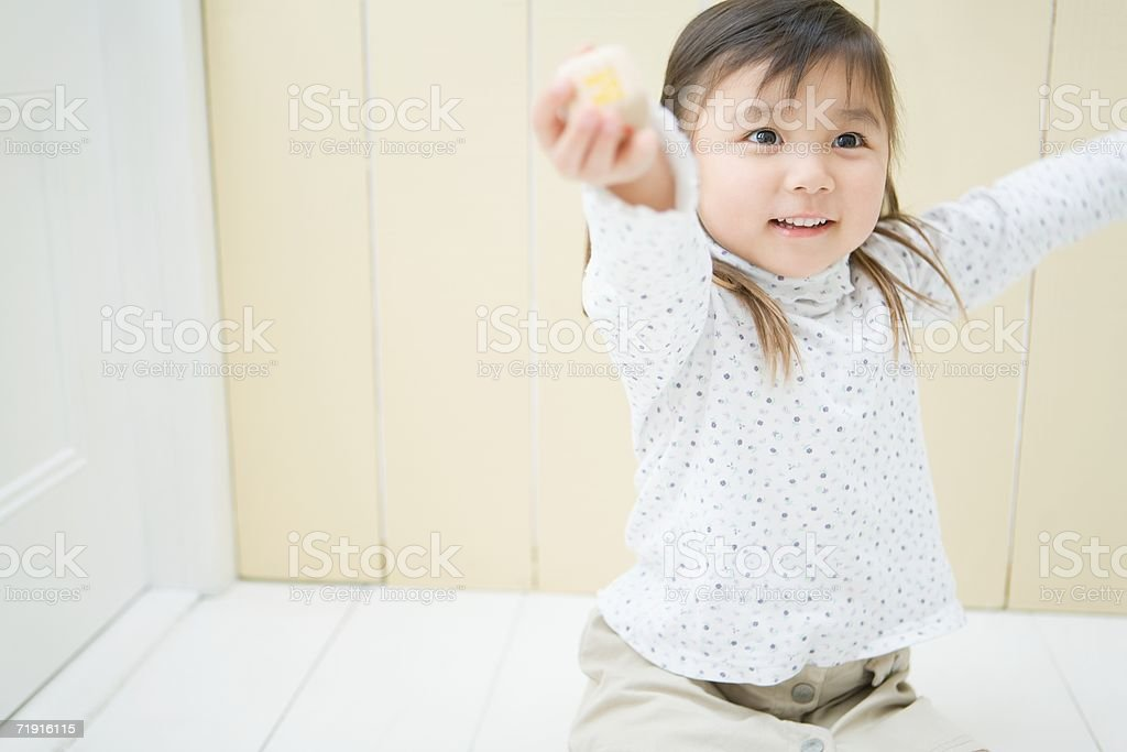 Japanese girl with her arms raised stock photo