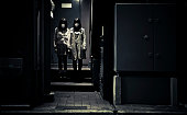 japanese girls with mask standing at a building entrance